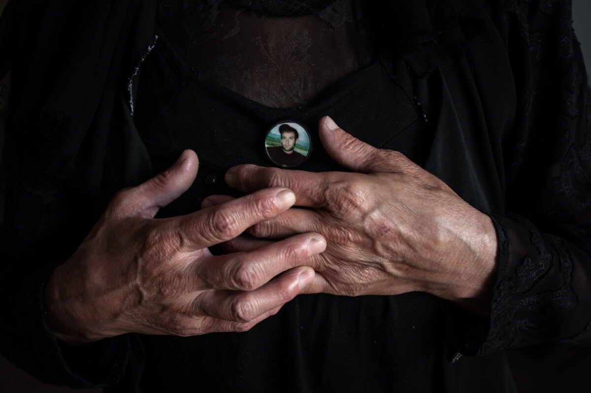 Mother is in mourning for her son. New Athos, Abkhazia. (Olga Ingurazova)