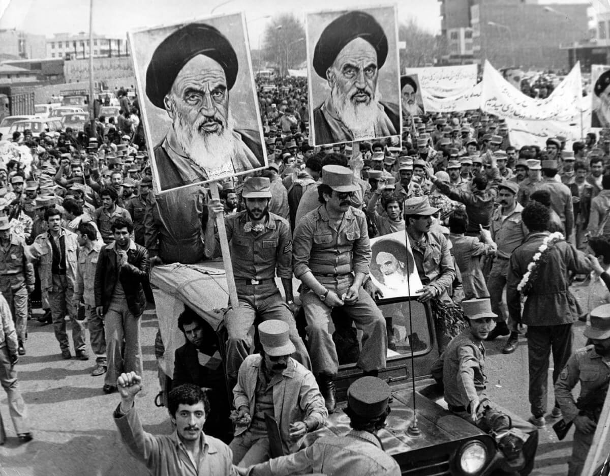People in the street during the Iranian revolution in 1979, carrying posters of the Ayatollah Khomeini. (Keystone/Getty images)