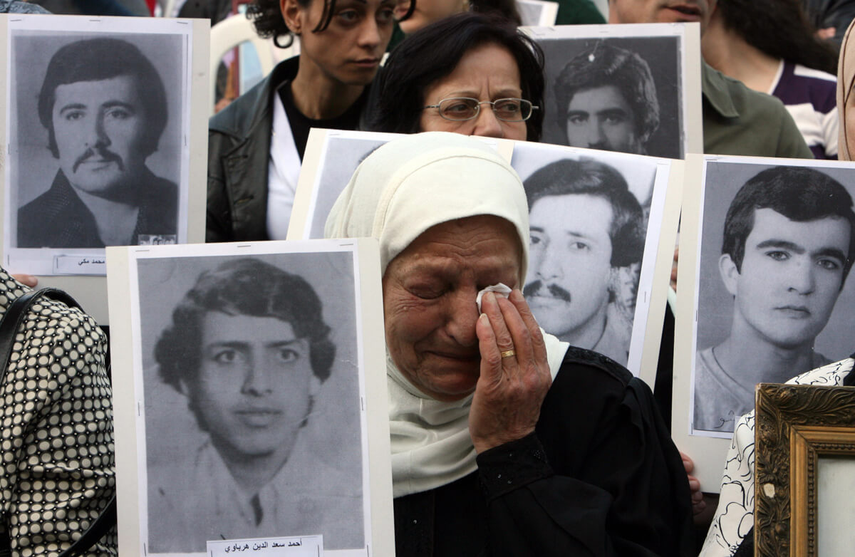 Relatives of persons missing during the Lebanese civil war gather in Beirut on April 13, 2009 to mark the 34th anniversary of the outbreak of the war (AFP/Ramzi Haidar)