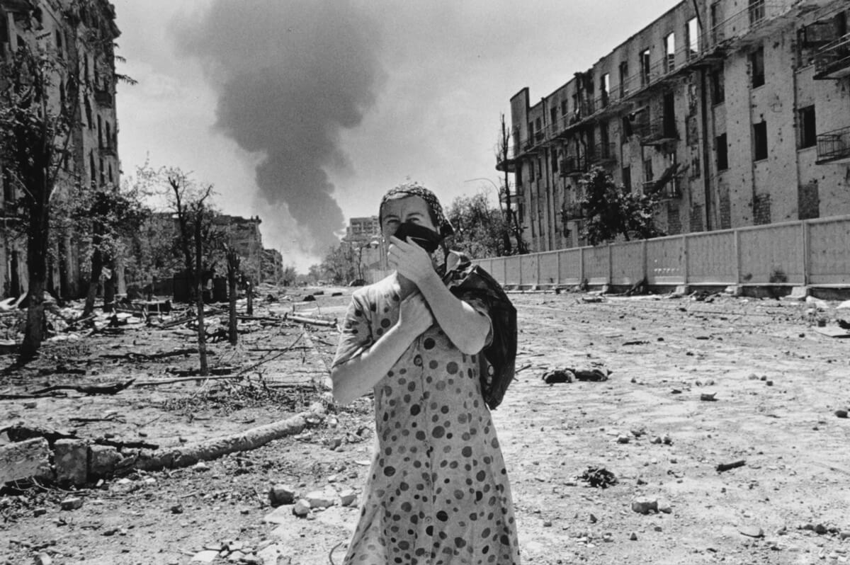 A woman in the urban battleground of Grozny, 1996.