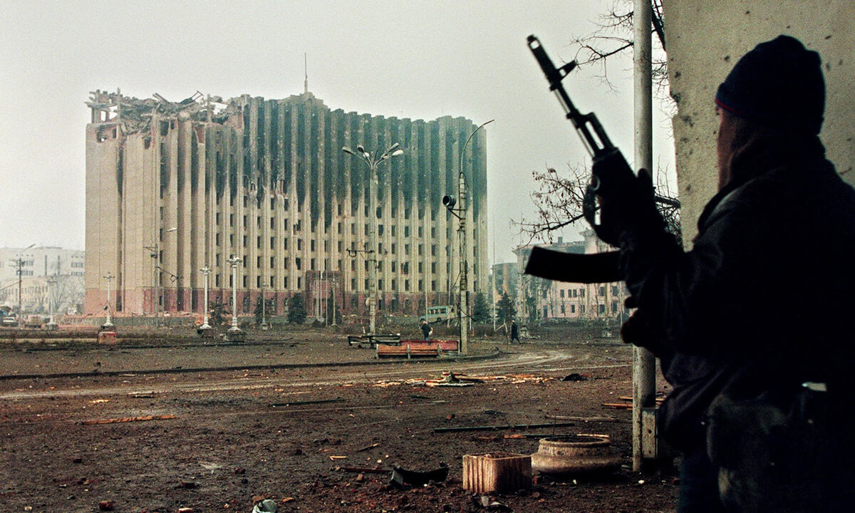 A Chechen fighter taking cover from sniper fire in Grozny, 1995.