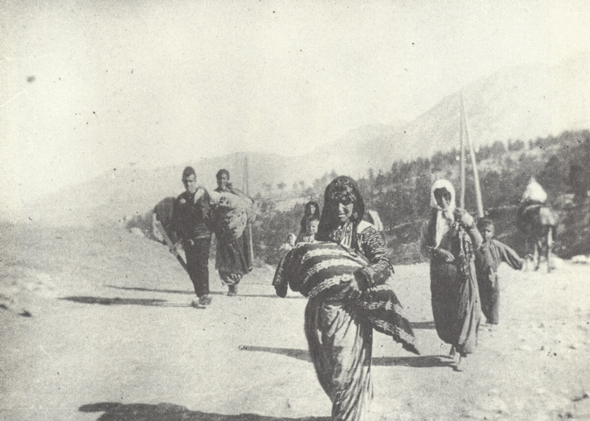 Armenian Genocide. An Armenian woman forced to march in the desert carrying her child. (OPB.ORG)